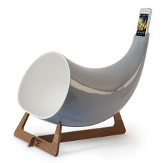 Megaphone/Grey by Enrico & Isabella Lovero  $585.00 This beautiful iPhone Megaphone uses natural acoustics to amplify the existing speaker on an iPhone. The designers wanted to juxtapose the electronic complexity of the iPhone with the low-tech simplicity of a ceramic horn. Made in the Italian city of Nove, a region famous for its ceramic works, each Megaphone is crafted by hand