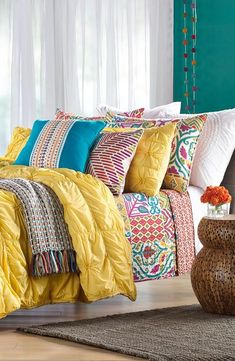 Bright colors mixed with bold patterns are perfect for a bedroom summer makeover!