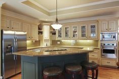 tray ceiling combined with ceiling flush with cabinets