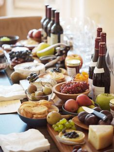 My favorite dinner: assorted vegetables, fruits, cheese, a few slices of ham, marinated olives, a crusty baguette and a nice red wine.