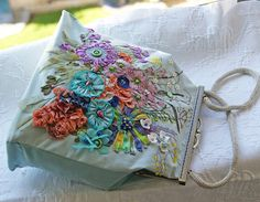 A #Bag with closure. #Embroidered ribbons and threads were used for this embroidery. Handwork. Absolute #unique, there is really only 1 copy. There will not be a repeat flower... #embroidery #bag #handmade #silk #ribbon #embroidered #handbag
