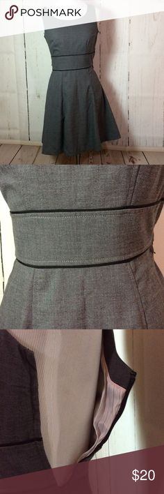 H&M A-Line gray dress Gray A-Line dress with horizontal waist band outlined with black trim.  Side zipper.  This is a great dress that can be worn with a blazer during the day and with accent jewelry for the evening. Runs small for size 2, more like an XS. H&M Dresses