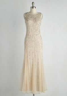 Once you slip into in this champagne-hued gown, you won't be able to keep the excitement to yourself - its style must be shared with the world! You'll fill your schedule with swanky occasions just to show off the iridescent and silver sequins and beads that radiate down this floor-length dress like rays. What a 'gleam' come true!