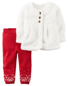 She's super snuggly in a fuzzy sherpa top and sweater knit pants.