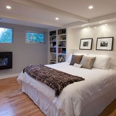 master bedroom in basement. bumpouts for bookshelves. track lighting