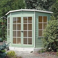 Make the most of an unused corner of your garden with this Shire Hampton Traditional Corner Wooden Summerhouse. Visit Shedstore for more information and our fantastic range of summerhouses. Wooden Summer House, Corner Summer House, Summer House Garden, Home And Garden, Summer Houses, Outdoor Buildings, Garden Buildings, Outdoor Structures, Sheds Direct