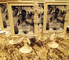 Picture frames and candle sticks used to make centerpieces for my son's baptism