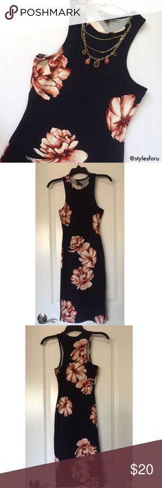 "NWT. Navy floral bodycon sleeveless midi dress NWT. Navy floral bodycon sleeveless midi dress. Slightly stretchy material. Round neckline. About 38.5"" long. Sorry, no trades. Iris Dresses Midi"