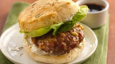 Move over burgers with ketchup. Try this flavorful turkey burger served in flaky biscuits with a standout sauce.