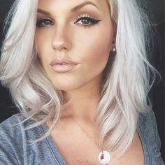Silver / white / bleach blonde mid length / shoulder length haircut