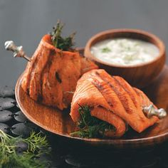Salmon Spirals with Cucumber Sauce. Use 4-oz cuts of salmon and skip the roll-it-up bit when in a hurry. Just bake the filets in a dish with the lime-mustard marinade.