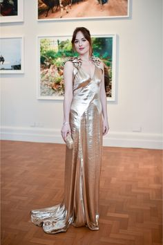 Inside the Vogue 100 Opening Party: Dakota Johnson in a Marc Jacobs gold dress