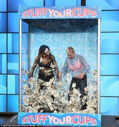 Making it rain!The 48-year-old Oscar winner and the 57-year-old host both donned volumino...