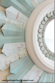 Made from Scrapbook paper and  ceiling medallion! Full Tutorial for DIY Sunburst Mirror ~Setting for Four