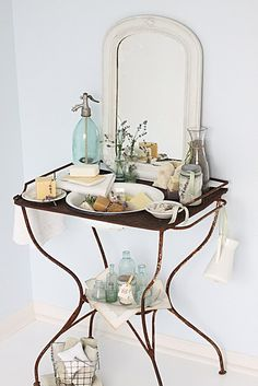 I have one of these crazy metal washstands in my garage! Never occurred to me to use it for a vignette! I think it would be perfect in the guest bedroom with little guest towels, soaps, shampoos, etc. Fairytale House, Cottage Bath, Shabby Chic, Wash Stand, French Country House, Guest Towels, Cool Lighting, Bathroom Accessories, Decorating Your Home