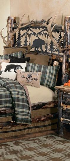 Aspen Log & Antler Bed: Rugged dark-finished aspen logs combine with fine details on this rustic bed with Metal Art Bear for an elegantly rustic look.