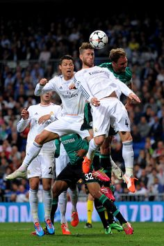 Sergio Ramos and Cristiano Ronaldo attack the same header during the UEFA Champions League round of 16, second leg match between Real Madrid CF and Schalke 04 at Estadio Santiago Bernabéu on March 18, 2014 in Madrid, Spain.