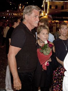 Happy days: Barbra was delighted to be in the company of her charming husband James, who d...