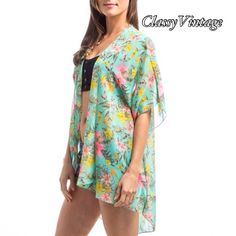 Mint garden print Kimono cardigan NWT This comes in 3 sizes and this is small. Made in USA and run true to size. Flowy floral print in chiffon. Bust up to 35 Boutique Tops
