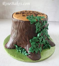 Tree Stump Cake Side Heather I think this is the one, but without the ivy and with the carving. Could I put a few butterflies, bugs, or flowers on around it? Fairy Birthday Cake, First Birthday Cakes, Fondant Tree, Sloth Cakes, Tree Stump Cake, Bug Cake, Woodland Cake, Tree Cakes, Fairy Cakes