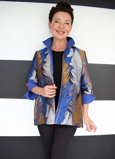 July 2018 This Joseph Ribkoff statement jacket is featured in our Shepherd's Fashion Friday Dress your Body Shape Series. It's clean angled lines flatter most body shapes, most notably the Apple, as it adds soft shoulder structure, and glides over the rounded mid-section. Shop now at ShepherdsFashions.com  J RIBKOFF-PRINT MANDARIN COLLAR JACKET #DressYourBodyShape #BodyShape #AppleShape #Apple #ShepherdsFashions #Shopping #JosephRibkoff Mandarin Collar Jacket, Feather Design, Body Shapes, Joseph, Rain Jacket, Shop Now, Windbreaker, Kimono Top, Dressing
