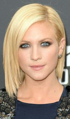 Sleek Shoulder Length Hairstyle With Lengthy Side Swept Bangs.