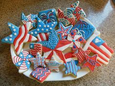 Patriotic 4th of July decorated sugar cookies  Followed Barn star tutorial by http://www.semisweetdesigns.com/2013/06/24/patriotic-barn-star-cookies/  Pinwheels followed this tutorial by klickitat street http://www.klickitatstreet.com/  Star with blue and stripes one was on karenscookies.net http://www.karenscookies.net/Cookie-Projects-Patriotic-Stars_ep_151-1.html The other sticker saw at iparty