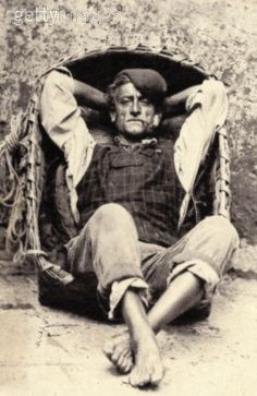 Welsh fisherman sitting in his coricle (boat)