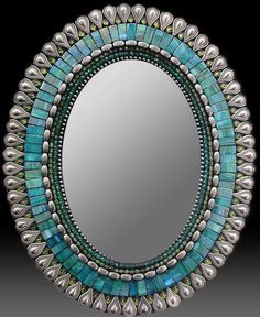 I would love to create something similar with the frame-less oval mirror in our powder room.