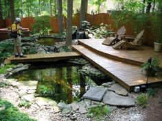 Lawn & Garden:Pleasant Backyard Home Garden Design With Wooden Patio Decking Also Natural Small Fish Pond Plus Artificial Waterfall Beautiful Small Pond Design to Complete Your Home Garden Ideas