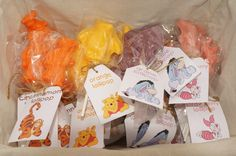 Winnie the Pooh Lollipop party favors: Cinnamon orange Tigger, Orange yellow Pooh, Grape blue Eeyore and Pink strawberry Piglet