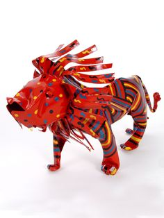 Large Tin Lion - The lion is a symbol of courage and fearlessness. Out of all the wildlife in Africa, no animal arouses as much awe and admiration as the African lion. As the largest of Africa's big cats, the 'King of the Jungle' represents power, strength and majesty.  $36.00