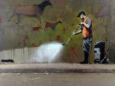 Several great Banksy street art pieces.