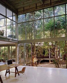 Artist Ririkrit tiravanija, said to his former student architect Aroon Puritat, when building his new home 'don't knock down trees'. So this beautiful rough concrete home is raised from the ground to keep foundations to a minimum, and zig zags organically through the existing forrest.