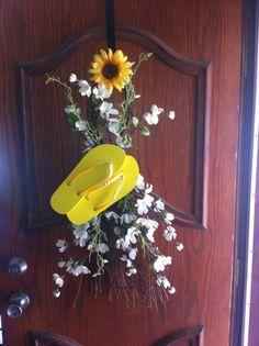 My fun summer door wreath my mom made me!