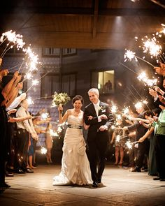 Heat up a cold winter night with a sparkler exit via StyleUnveiled.com / Alante Photography #winterwedding #sparklerexit
