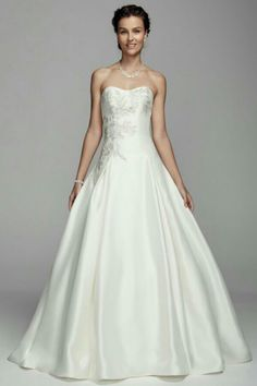 Gorgeous Mikado Bridal Ball Gown Showcasing A Semi Sweetheart Strapless Neckline With Beaded Lace Appliquéd Bodice, Box Pleated Skirt & Satin Covered Buttons Down The Back & Chapel Length Train; Oleg Cassini Collection for David's Bridal