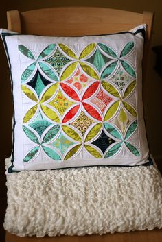 Cathedral window pillow by sixorangesocks, via Flickr