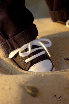 Petites baskets dans le sable