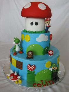 """Super Mario Brothers Cake - Buttercream iced 10"""" and 6"""" cakes -one was chocolate/chocolate chip and the other was white almond sour cream. The mushroom was make from half of the Wilton ball pan and two 4"""" cakes and covered in fondant. All decorations are fondant (except the Mario, Luigi, and Yoshi which are toys the birthday boy got to keep.) This cake was a lot of work but a ton of fun to do :)"""