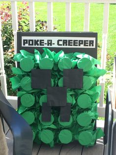 Poke-a-creeper game.  Each cup was filled with a prize.  The kids poked their fingers into the cup and found things like fake mustaches, gems, bubbles, etc.  How-to: Use a hot glue gun to glue the bottom of solo cups to a piece of foam board. Fill each cup with a prize. Cover each cup with a green napkin. Secure with a rubber band.   Place black napkins on top in shape of creeper face. Each child sticks finger through a napkin and retrieves the prize inside!