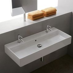 "Teorema 39.3"" Wall Mounted Bathroom Sink with Overflow This, atop a double vanity"