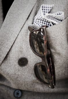 Retro glasses. Modern wool jacket.