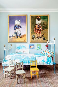 A Parisian child's bedroom with Hello Kitty historic paintings and antique, colorful furniture