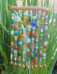 Beaded Wind Chime; this one is for sale on etsy and is beautiful....i think i could DIY it.....look for random beads/broken necklaces etc in my stuff and at thrift stores
