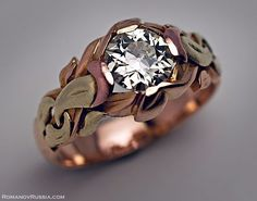 An elaborate Art Nouveau intertwined leaf design in rose, green, and yellow gold.