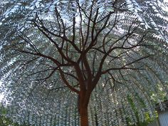 20' metal tree made from recycled steel. - Foster Talge. I hope this isn't in an area where there are lots of thunderstorms