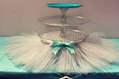 "- Three tier cupcake stand, two levels of crystal plate and an aqua plate on top (perfect for a round cake) - Each level is divided with crystal candleholders along with another 3 on the bottom as ""fe"