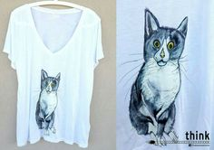 Handpainted cat illustration on woman's t-shirt.