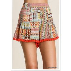 ARRIVAL! Tangerine mix print Pom Pom shorts Material: 65% cotton, 35% polyester.  Fits true to size. Elastic waistband as shown in pictures. Pink Peplum Boutique Shorts
